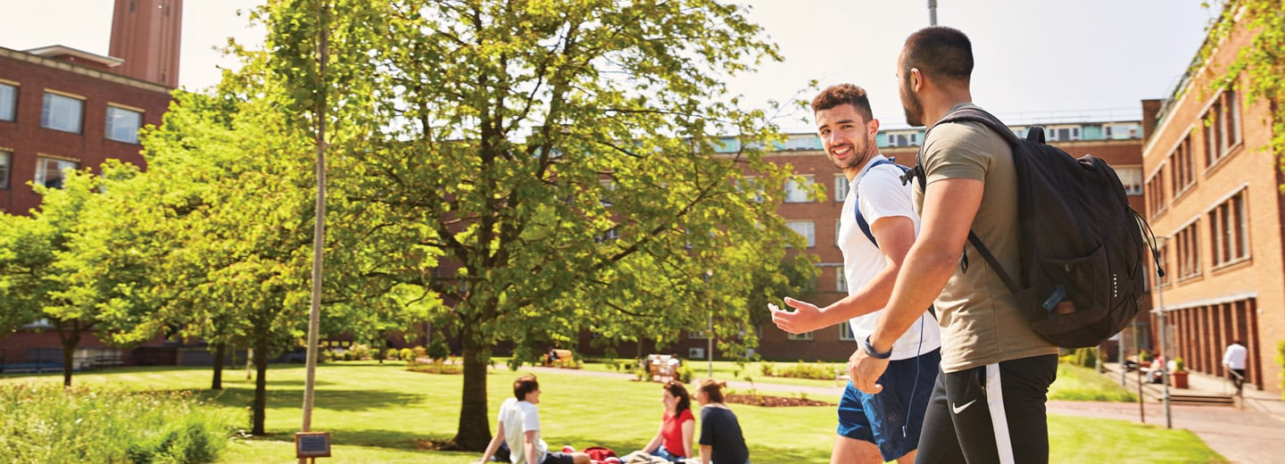 Two students walking outside on the University of Birmingham campus